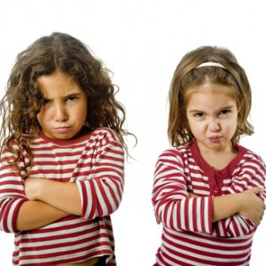 two little girls  in quarrel isolated on white